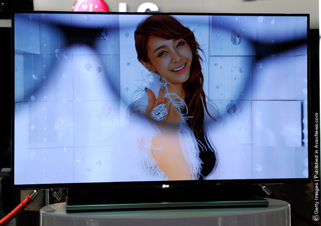 An LG 55-inch 3-D OLED TV is is partially seen through a pair of 3-D glasses at the LG Electronics booth at the 2012 International Consumer Electronics Show