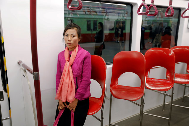 A woman travels on a train stopping at a subway station visited by foreign reporters in central Pyongyang, North Korea on April 14, 2017. (Photo by Damir Sagolj/Reuters)