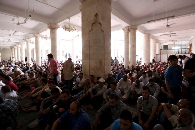 Men attend the last Friday prayer of the Muslim holy month of Ramadan at al-Husainy mosque in downtown Amman, Jordan, July 10, 2015. (Photo by Muhammad Hamed/Reuters)