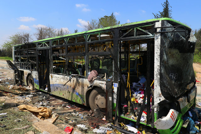 A damaged bus is seen after an explosion yesterday at insurgent-held al-Rashideen, Aleppo province, Syria April 16, 2017. (Photo by Ammar Abdullah/Reuters)