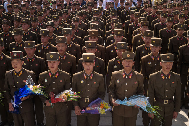 Korean People's Army (KPA) soldiers wait to pay their respects before the statues of the late North Korean leaders Kim Il Sung and Kim Jong Il as the country marks the 25th anniversary of death of Kim Il Sung, at Mansu Hill in Pyongyang on July 8, 2019. (Photo by Kim Won Jin/AFP Photo)