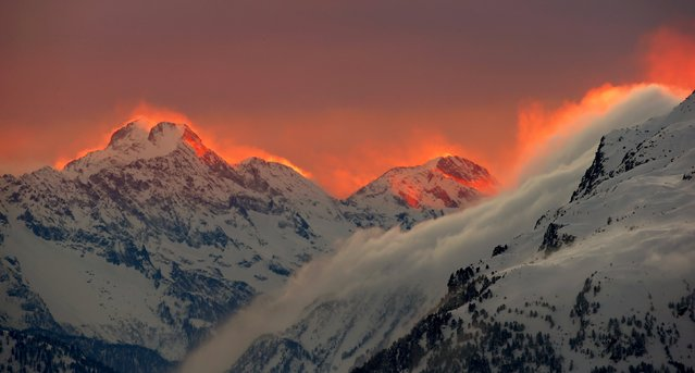 The sunset illuminates the peaks of the mountains near the Swiss mountain resort of St. Moritz, in this January 24, 2015 file photo. (Photo by Arnd Wiegmann/Reuters)
