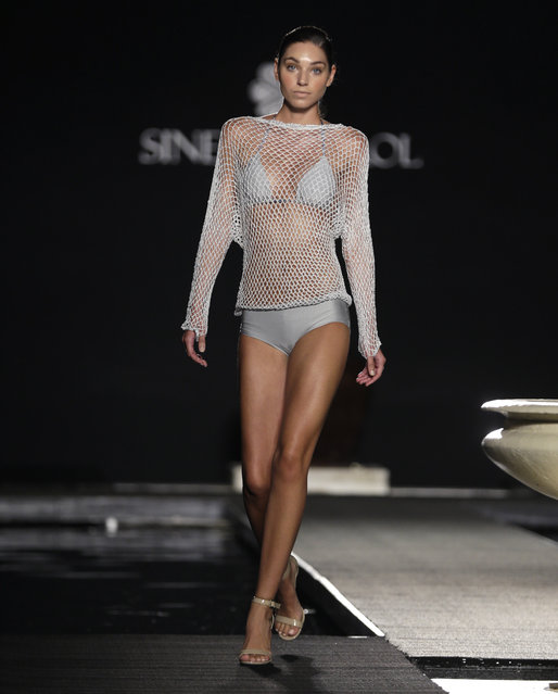 A model walks down the runway during the Sinesia Karol swimwear show as part of Funkshion Fashion Week Swim, Friday, July 17, 2015, in Miami Beach, Fla. (Photo by Lynne Sladky/AP Photo)