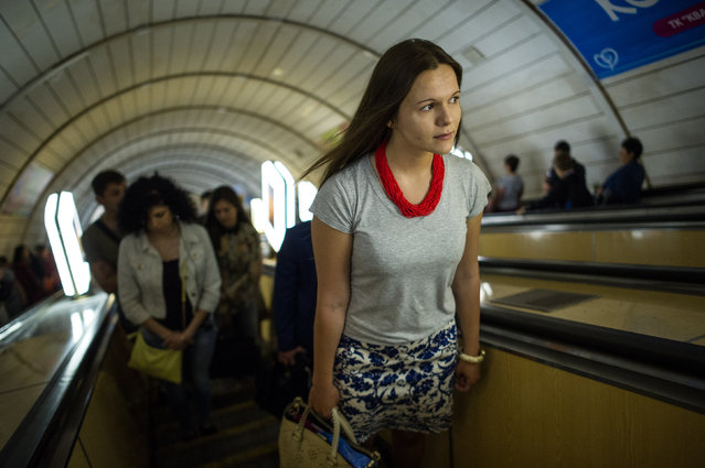 Daria Mykhailova, a student, is seen in the Kyiv subway on her way from home to the university, on May 23, 2014, in Kiev, Ukraine. (Photo by Alexey Furman/The Washington Post)