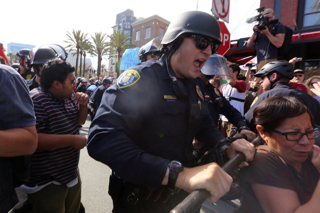 Police shove demonstrators outside a campaign event for Republican U.S. presidential candidate Donald Trump in San Diego, California, U.S. May 27, 2016. (Photo by David McNew/Reuters)