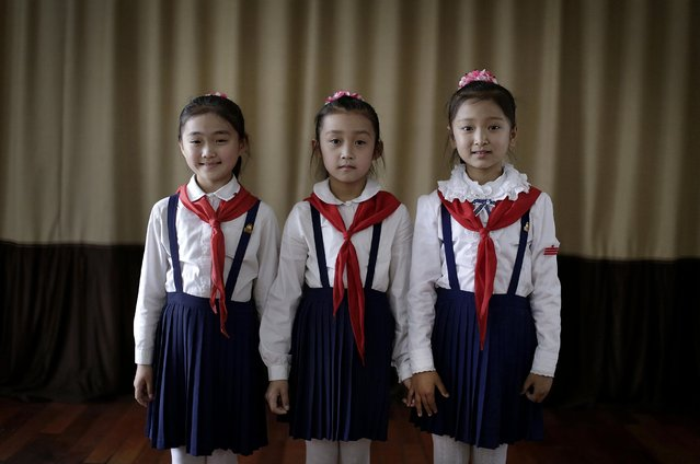 Sin Ji Ye, 9, left, An Rye Jong, 10, center, and Kim Ye Yon, 8, right, who all want to grow up to become professional singers, attend a singing class which they have been taking for two, four and one year respectively, Thursday, May 7, 2015 in Pyongyang, North Korea. The Pyongyang School Children's Palace, which opened in 1963 is a place where talented school children go to learn extra curricular activities, and is also one of the places that tourists visit while in Pyongyang. (Photo by Wong Maye-E/AP Photo)
