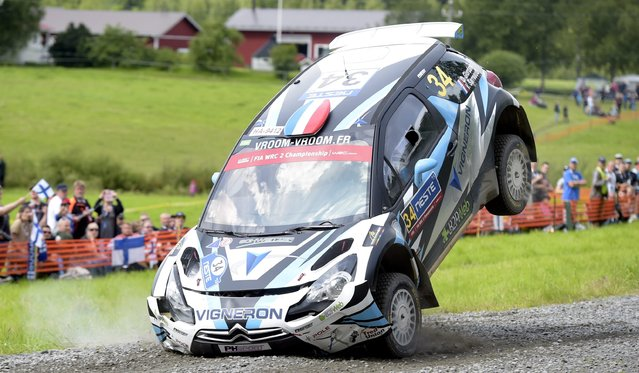 French WRC2 Citroen DS3 RRC driver Quentin Giordano and co-pilot Valentin Sarreaud land after a jump, during the Ouninpohja special stage of the 2015 FIA World Rally Championship WRC Rally of Finland in Jyvaskyla, Finland, on Friday July 31, 2015. (Photo by Vesa Moilanen/Lehtikuva via AP Photo)