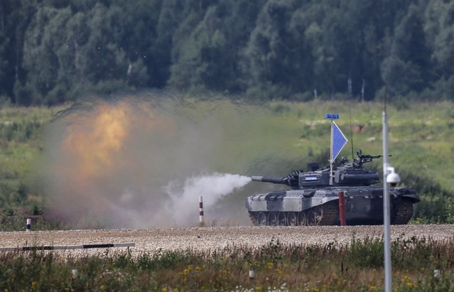 A tank fires at a target on the course of the Tank Biathlon competition during an opening ceremony of the International Army Games-2015 in Alabino, outside Moscow, Russia, August 1, 2015. (Photo by Maxim Shemetov/Reuters)