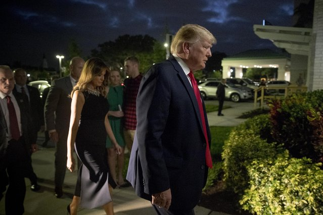President Donald Trump and first lady Melania Trump arrive for Christmas Eve service at Family Church Downtown in West Palm Beach, Fla., Tuesday, December 24, 2019. (Photo by Andrew Harnik/AP Photo)