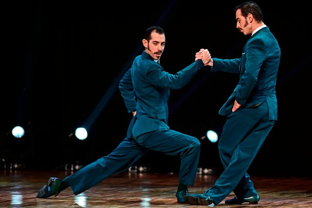 Argentinian twin dancers Nicolas Filipeli and German Filipeli perform during the Tango Stage final competition at the Tango Dance World Championship in Buenos Aires on August 21, 2019. (Photo by Ronaldo Schemidt/AFP Photo)