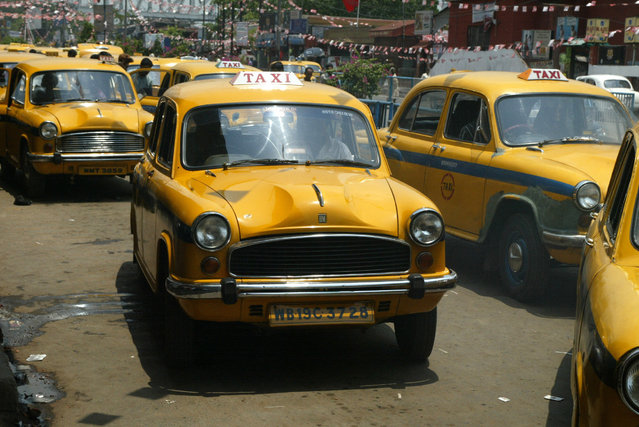 Ambassador cars, manufactured by Hindustan Motors, popularly used as Taxis are seen in Calcutta, India, Wednesday, May 2, 2007. (Photo by Bikas Das/AP Photo)
