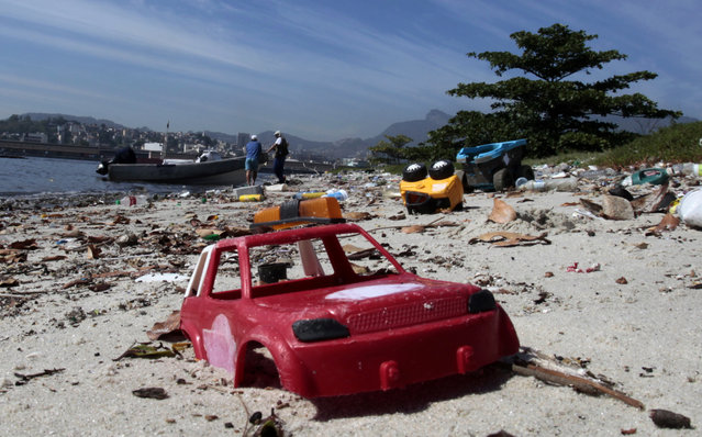A toy is seen at Pombeba island in the Guanabara Bay in Rio de Janeiro March 12, 2014. (Photo by Sergio Moraes/Reuters)