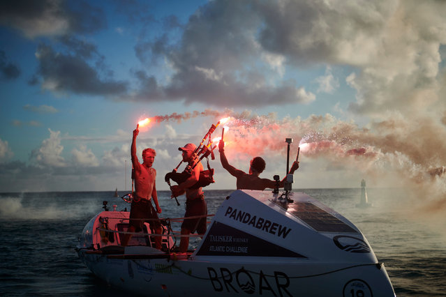 (L-R) Lachlan, Jamie, and Ewan celebrate their arrival in Antigua on January 17, 2020. Brothers Jamie,26, Ewan, 27, and Lachlan, 21, MacLean have become the fastest and youngest trio to row across the Atlantic – from La Gomera in Spain to Antigua in the Caribbean in just 35 days nine hours and nine minutes – being the previous record by six days. (Photo by Ben Duffy Photography/PA Wire Press Association)