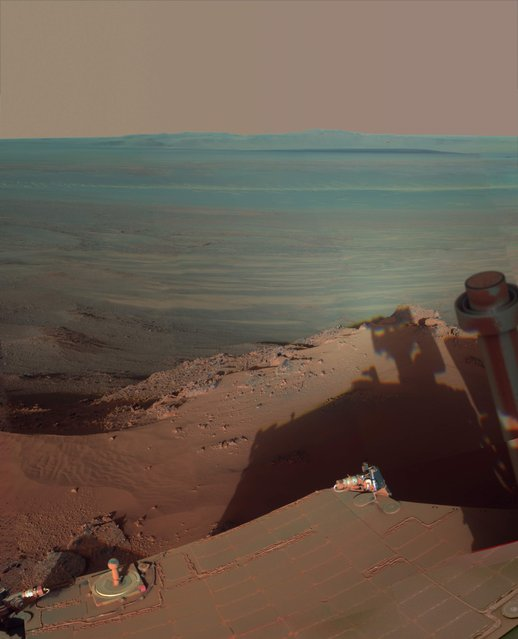 NASA's Opportunity rover catches its own late-afternoon shadow in a view looking eastward across Endeavour Crater on Mars