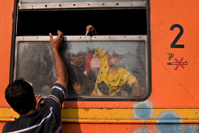 Migrants sit on a train at Gevgelija train station in Macedonia, close to the border with Greece July 30, 2015. (Photo by Ognen Teofilovski/Reuters)