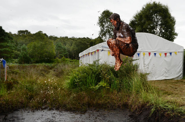 A male entrant takes a dip in the Bog Jacuzzi after takes part in the Irish Bog Snorkelling championship this afternoon at Peatlands Park on July 27, 2014 in Dungannon, Northern Ireland. The annual event sees male and female competitors swim the 60m length of the bog watched by scores of spectators and takes place on International Bog Day. (Photo by Charles McQuillan/Getty Images)