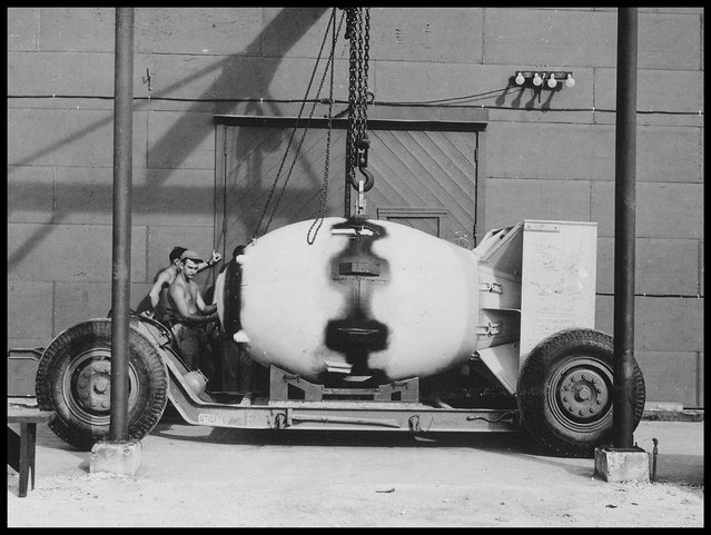 """""""Fat Man"""" on transport carriage, Tinian Island, 1945. """"Fat Man"""" was the codename for the type of atomic bomb that was detonated over the Japanese city of Nagasaki by the United States on 9 August 1945. (Photo by: Universal History Archive/UIG via Getty Images)"""