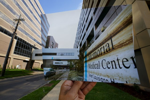 Photographer Carlos Barria holds a print of a photograph he took in 2005, as he matches it up at the same location 10 years on, in New Orleans, United States, August 17, 2015. The print shows a general view of the Memorial Medical Center, September 13, 2005, after Hurricane Katrina struck. (Photo by Carlos Barria/Reuters)