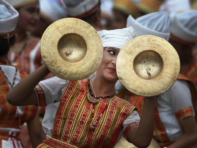 A dancer performs during Independence Day celebrations in Gauhati, India, Friday August 15 2014. India celebrates its 1947 independence from British colonial rule on August 15. (Photo by Anupam Nath/AP Photo)