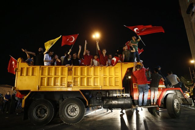 "People shout slogans on as truck during a demonstration against the failed Army coup attempt at Taksim Sqaure, in Istanbul, Turkey, 16 July 2016. Turkish Prime Minister Yildirim reportedly said that the Turkish military was involved in an attempted coup d'etat. The Turkish military meanwhile stated it had taken over control. According to news reports, Turkish President Recep Tayyip Erdogan has denounced the coup attempt as an ""act of treason"" and insisted his government remains in charge. (Photo by Sedat Suna/EPA)"