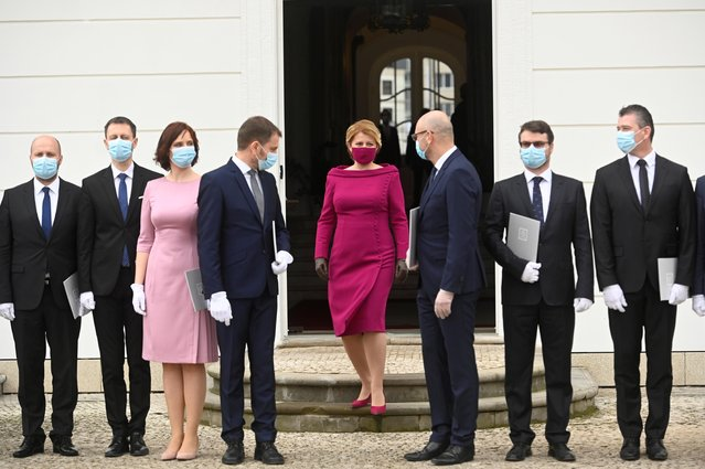 Slovakia's President Zuzana Caputova wearing a protective face mask walks to pose for a group photo with newly appointed members of the Slovak government during the cabinet's inauguration at Presidential Palace in Bratislava, Slovakia, March 21, 2020. (Photo by Radovan Stoklasa/Reuters)