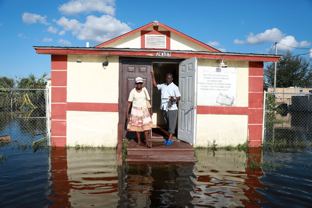 Pastor Louicesse Dorsaint stands with his wife Maria Dorsaint in front of their church, Haitian United Evangelical Mission, which was damaged by flooding from Hurricane Irma in Immokalee, Florida, U.S. September 12, 2017. (Photo by Stephen Yang/Reuters)