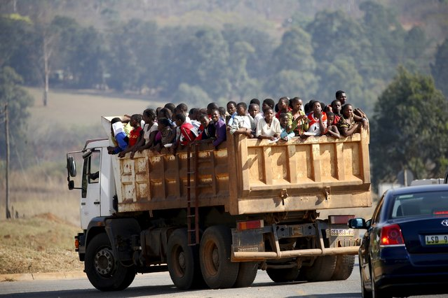 Maidens riding in the back of a dump truck arrive ahead of the last day of the Reed Dance at the Ludzidzini royal palace in Swaziland August 31, 2015. (Photo by Siphiwe Sibeko/Reuters)