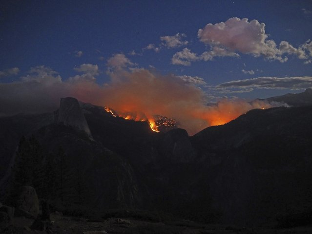 The Meadow Fire burns near Half Dome in Yosemite National Park, California, in this handout photo released to Reuters on September 8, 2014. The so-called Meadow Fire, which flared out of control on Sunday afternoon, stranded 85 hikers on top of Half Dome, the park's signature rock formation, requiring them to be flown out by helicopter, Yosemite spokeswoman Ashley Mayer said. (Photo by Jeffrey Trust/Reuters/National Park Service)