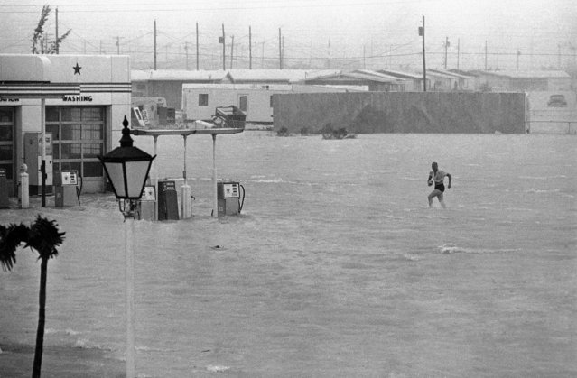 This was the scene in Key West, Florida on September 8, 1965, after Hurricane Betsy slammed into this most southern Key with 100-miles-per-hour winds. Two feet of water stands in this gas station near downtown Key West. (Photo by Horace Cort/AP Photo)