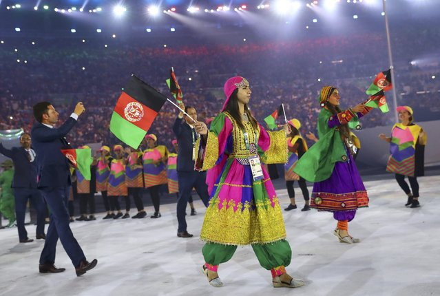 2016 Rio Olympics, Opening ceremony, Maracana, Rio de Janeiro, Brazil on August 5, 2016. The Afghanistan (AFG) team arrives for the opening ceremony. (Photo by Kai Pfaffenbach/Reuters)