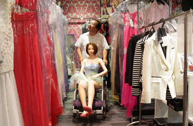 "Senji Nakajima looks for clothes for his Love Doll ""Saori"" on June 25, 2016 in Gunma, Japan. (Photo by Taro Karibe/Getty Images)"