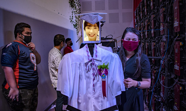 """The face of a graduating student is displayed on a tablet attached to a robot during a """"cyber graduation"""" ceremony at a school on May 22, 2020 in Taguig, Metro Manila, Philippines. Robots represented some 179 graduating students of the Senator Rene Cayetano Science and Technology High School during a graduation ceremony that was streamed online, as mass gatherings remain prohibited in the country under the Philippine government's lockdown to curb the spread of the coronavirus. The robots were developed by alumni of the school's robotics club, which used tablets to display the faces of the graduating students as they """"marched"""" on stage to receive their diplomas. The Philippines' Department of Health has so far reported 13,434 cases of the coronavirus in the country, with at least 846 recorded fatalities. (Photo by Ezra Acayan/Getty Images)"""