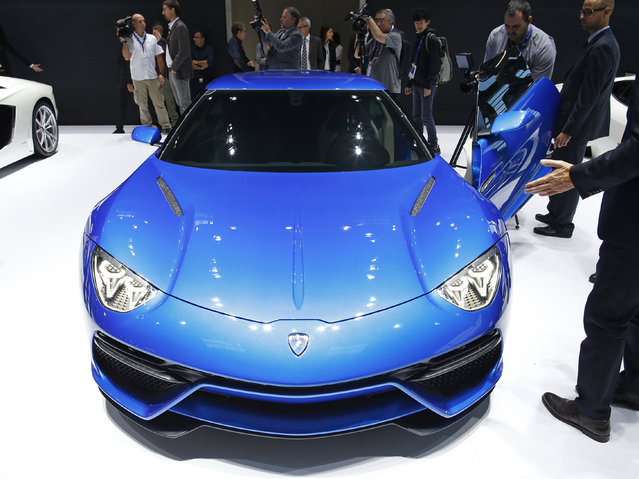 Visitors look at a Lamborghini Asterion car is displayed on media day at the Paris Mondial de l'Automobile, October 3, 2014. (Photo by Benoit Tessier/Reuters)