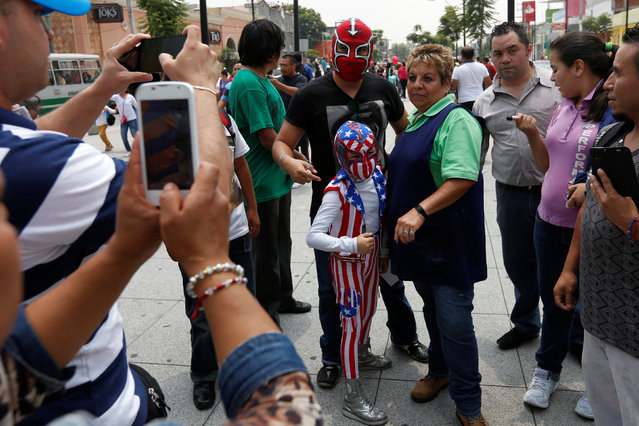 A child wearing a wrestler's costume poses for a photograph as he takes part in the annual pilgrimage to the Basilica of Our Lady Guadalupe in Mexico City, Mexico August 25, 2016. (Photo by Carlos Jasso/Reuters)