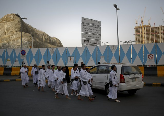 Muslim pilgrims walk towards the Grand mosque in the holy city of Mecca ahead of the annual haj pilgrimage September 21, 2015. (Photo by Ahmad Masood/Reuters)
