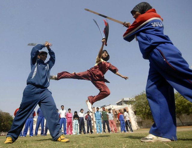Girls practise Chinese Wushu martial arts in Hyderabad March 8, 2010. (Photo by Krishnendu Halder/Reuters)