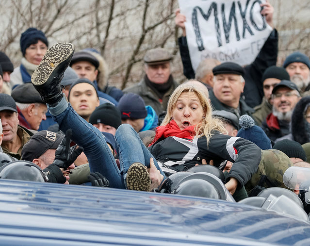 A supporter of former Georgian President Mikheil Saakashvili clashes with riot police in Kiev, Ukraine, Tuesday, December 5, 2017. It is unclear if Tuesday's events will lead to wider unrest, as Saakashvili enjoys limited support in Ukraine. Only 1.7 percent of voters would support his party, the Movement of New Forces, in elections, according to an October survey by the Kiev-based Razumkov Centre think-tank. (Photo by Gleb Garanich/Reuters)