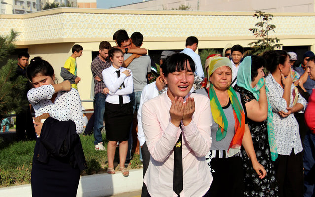 People react as they gather to meet a mourning motorcade and to pay the tribute to the memory of Uzbek late President Islam Karimov in Tashkent, Uzbekistan, September 3, 2016. (Photo by Muhammadsharif Mamatkulov/Reuters)