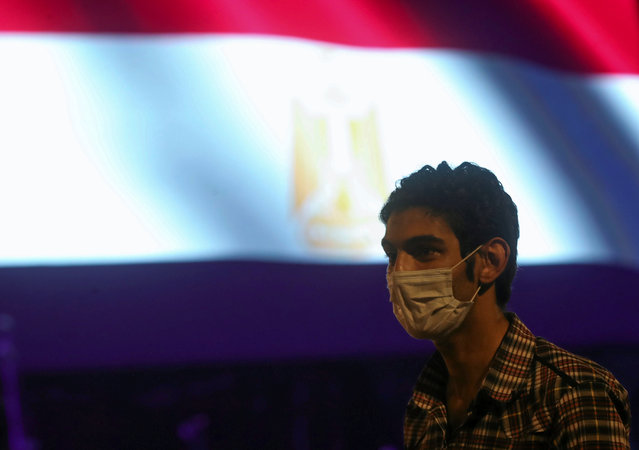 A man wearing protective face mask listens to the first concert of the Cairo Symphonic Orchestra after the Cairo Opera House reopened, amid concerns about the spread of the coronavirus disease (COVID-19), in Cairo, Egypt on July 18, 2020. (Photo by Mohamed Abd El Ghany/Reuters)