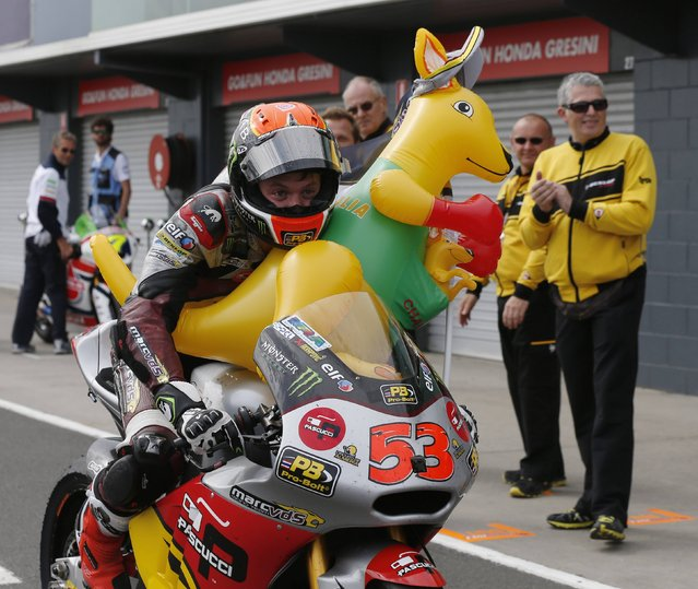 Kalex Moto2 rider Esteve Rabat of Spain rides into the pits with a inflatable kangaroo after placing third in the Australian Moto2 Grand Prix on Phillip Island October 19, 2014. (Photo by Jason Reed/Reuters)