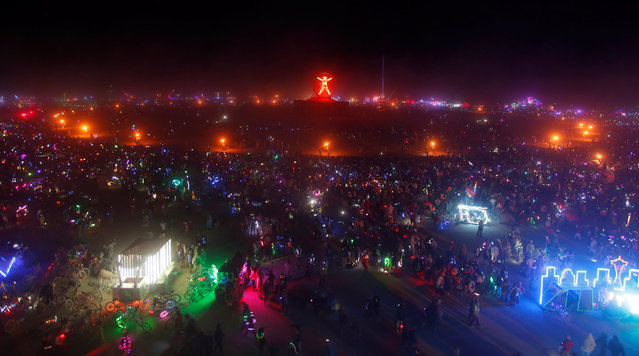 Participants fill the Playa as approximately 70,000 people from all over the world gather for the 30th annual Burning Man arts and music festival in the Black Rock Desert of Nevada, U.S. September 3, 2016. (Photo by Jim Urquhart/Reuters)