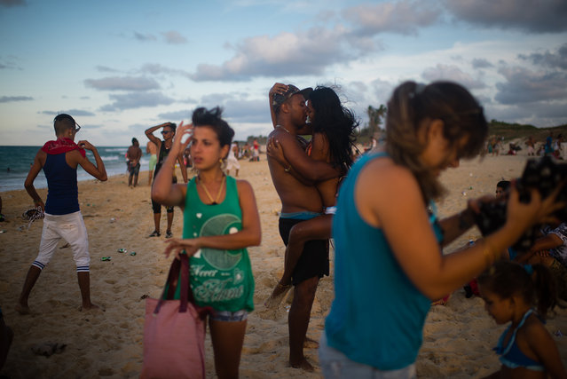 Roydel Cabrales, 35, kisses his girlfriend, Yineti Lozano, 18 at Santa Maria beach, about 15 miles from Havana. It is the closest beach to Havana. The government is demolishing buildings all over the coast of East Havana and recovering and restoring beach dunes. (Photo by Sarah L. Voisin/The Washington Post)