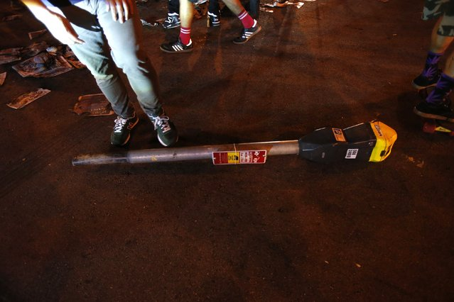 A broken parking meter is seen on the ground during a street celebration in San Francisco, California October 29, 2014. (Photo by Stephen Lam/Reuters)