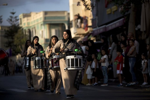 Israeli Arab youths, from the scouts youth movement, march in a parade for the Eid al-Adha festival in the mixed Arab Jewish neighborhood of Jaffa, near Tel Aviv, Israel, Monday, September 12, 2016. Muslims around the world will celebrate Eid al-Adha, the Festival of Sacrifice, to mark the end of the hajj pilgrimage by slaughtering sheep, goats, cows and camels to commemorate Prophet Abraham's readiness to sacrifice his son Ismail on God's command. (Photo by Oded Balilty/AP Photo)
