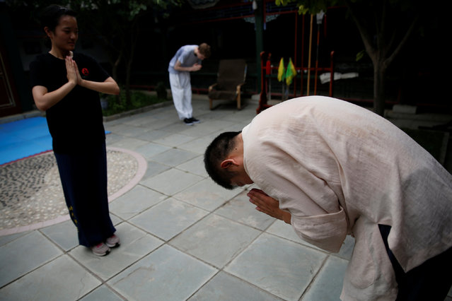 "Kung Fu master Xing Xi bows to his students after a class at his Kung Fu academy ""Kung Fu Zen"" in Beijing, China, July 3, 2016. (Photo by Kim Kyung-Hoon/Reuters)"