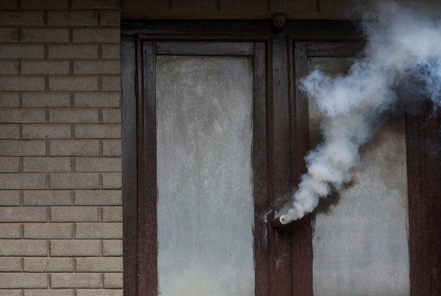 A teargas canister shot by police, pierces the window of a house during the protest after locals tried to pull the chariot of Rato Machhindranath amid the ban on public and religious gatherings to control the spread of the coronavirus disease (COVID-19) in Lalitpur, Nepal on September 3, 2020. (Photo by Navesh Chitrakar/Reuters)