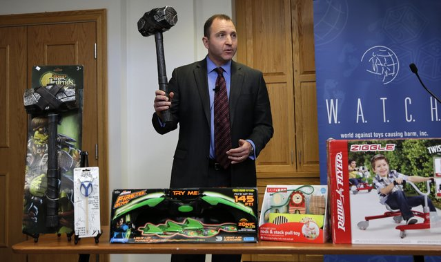 James Swartz, director of World Against Toys Causing Harm Inc., holds up toy battle hammer at Children's Franciscan Hospital in Boston, Wednesday, November 19, 2014. The consumer watchdog group has released its annual list of what it considers to be the 10 most unsafe toys as the holiday season approaches. (Photo by Charles Krupa/AP Photo)