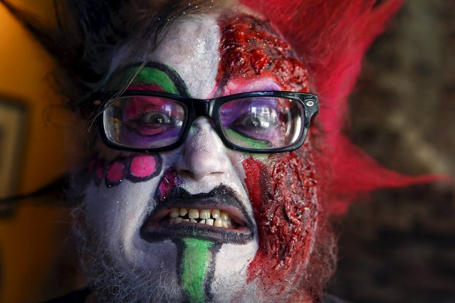 Zac Amico poses in costume after being made up as a zombie during the NYC Zombie Crawl in New York, October 18, 2015. (Photo by Shannon Stapleton/Reuters)