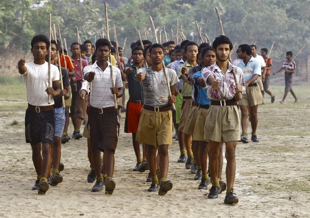 Volunteers of the Hindu nationalist organisation Rashtriya Swayamsevak Sangh (RSS) hold sticks as they march during a training session at Tatiberia village in West Bengal, India, in this May 20, 2015 file photo. (Photo by Rupak De Chowdhuri/Reuters)