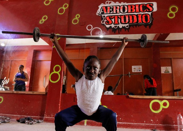Keysha Atiky, granddaughter of Kenyan weightlifter Mercy Obiero, lifts weights during a training session at a gym within Umoja estate in Nairobi, Kenya September 18, 2020. Obiero was only the second African woman to compete in weightlifting at the Olympics, representing her native Kenya in 2012. Now retired from professional competition, the 42-year-old works as a coach, and both her daughter and granddaughter are hoping to follow in her footsteps. (Photo by Monicah Mwangi/Reuters)